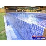 piscina de alvenaria com deck Jardim Aracília