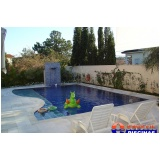 piscina de azulejo com cascata Jardim Veloso