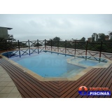 reforma de piscina de alvenaria com deck de madeira Vila Barros